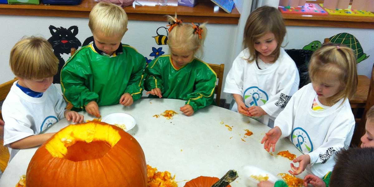 Children from Zion's weekday ministries carving a pumpkin